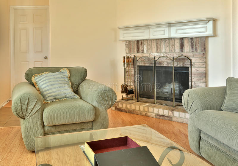 A nice family living room with fireplace. Interior of a nice family living room with fireplace royalty free stock photography