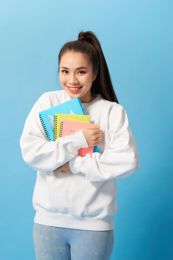 Nice female student smiling and looking at camera royalty free stock photos