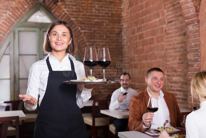 Nice female waiter showing country restaurant royalty free stock photos