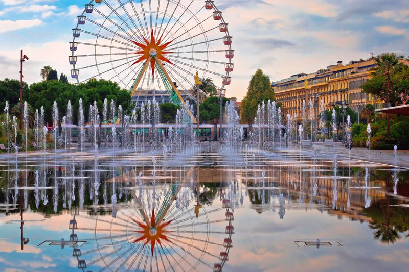Nice ferris wheel and cityscape fountain mirror view stock photography
