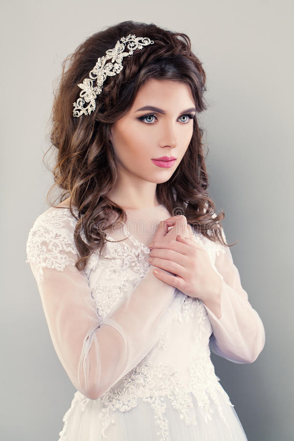 Nice Fiancee Girl Fashion Model. Portrait of Bride in White Dress. Wedding Makeup and Hair style stock photography