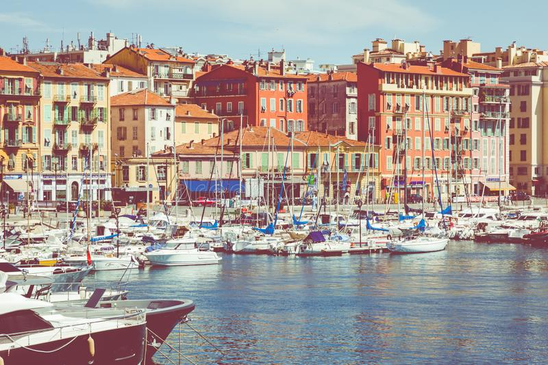NICE, FRANCE - JUNE 05, 2019: Old port of Nice. Yachts and fishing boats moored in the harbor of Nice, Cote d`Azur, France royalty free stock photography