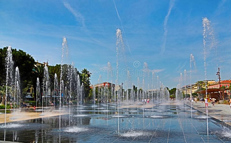 Nice, France - June 12, 2014: Promenade du Paillon and its fountains on a summer day. Promenade du Paillon in Nice, France, and its fountains on a summer day royalty free stock image
