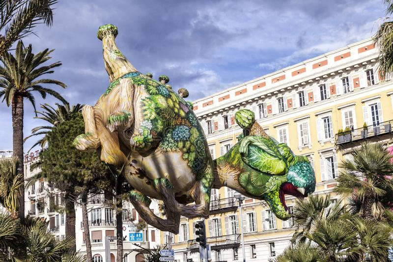 NICE - FRANCE - March 01, 2014: Carnival of Nice, Flowers ` battle. Aerostatic dragon stock photography