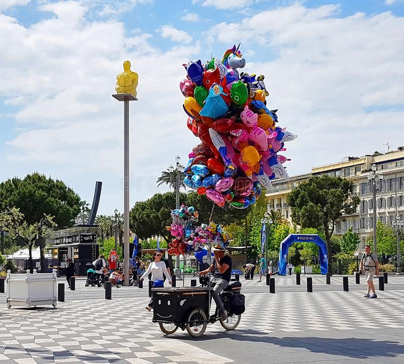 NICE, FRANCE - MAY 2018 : Souvenir sellers and tourists walking in the Place Massena in Nice, French Riviera, Cote d`Azur, France royalty free stock photo