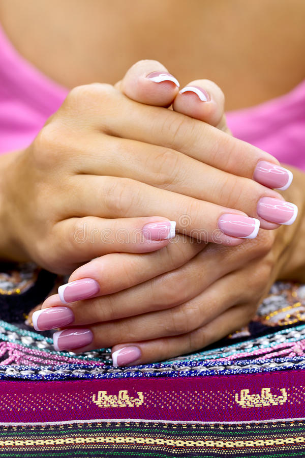 Nice french manicure. Women's hands with a beautiful french manicure royalty free stock image