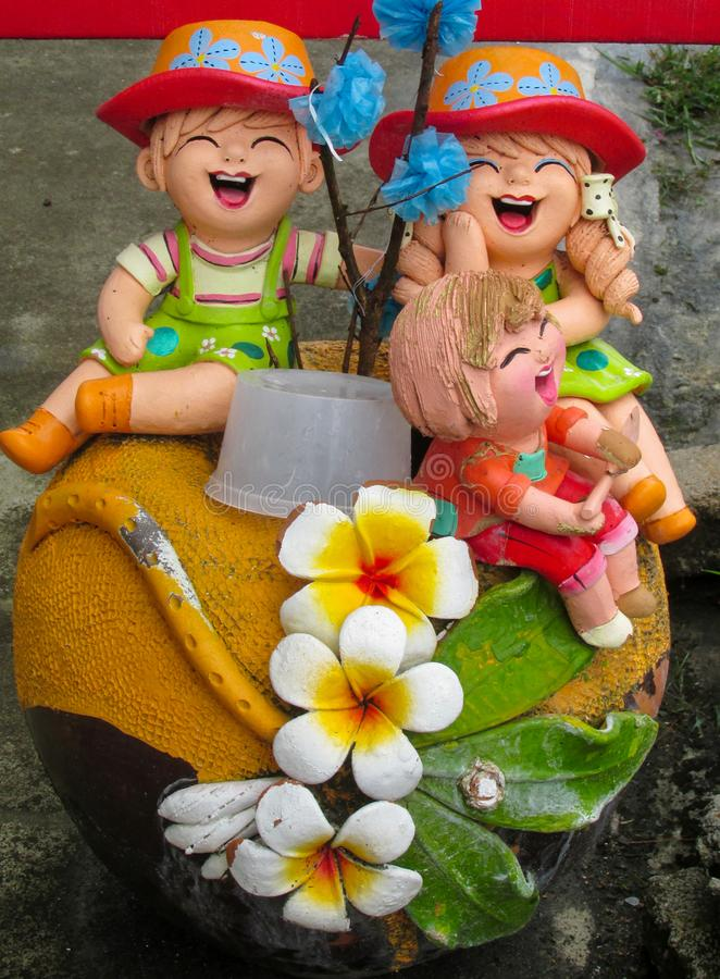 Nice funny colorful figures in asian garden stock image