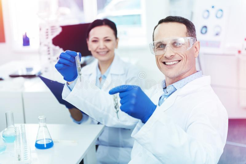 Nice genius researches studying test samples together royalty free stock image