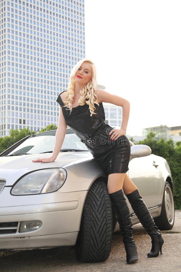 Nice girl with cabriolet car royalty free stock images