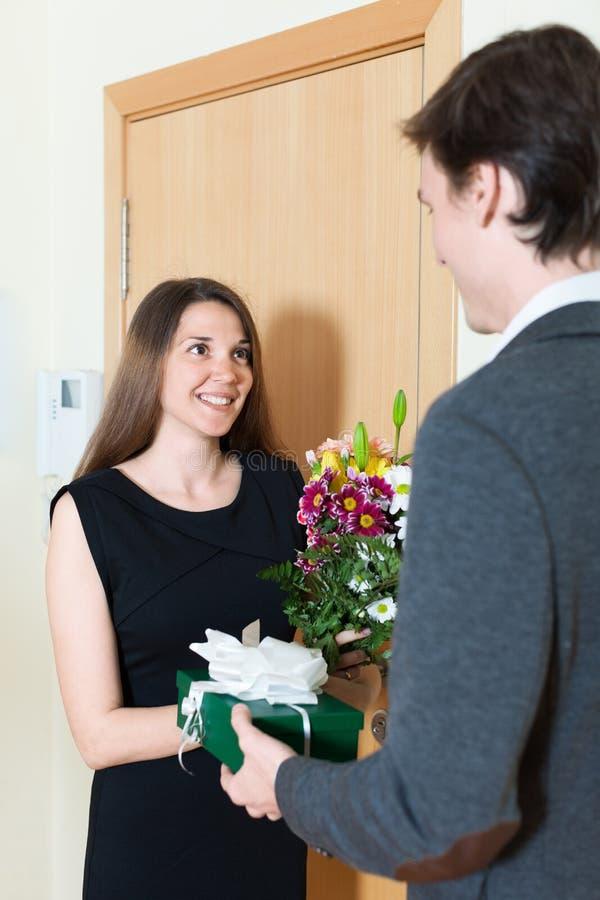 Nice girl giving gift. To man stock photo