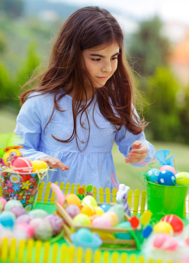 Nice girl playing with Easter eggs royalty free stock photo