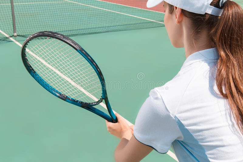 Nice girl playing tennis royalty free stock images