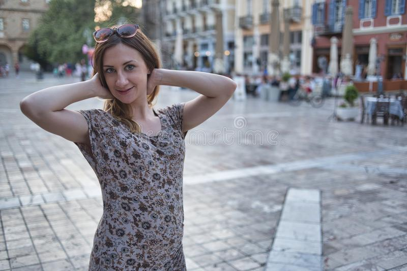Nice girl posing on square stock images