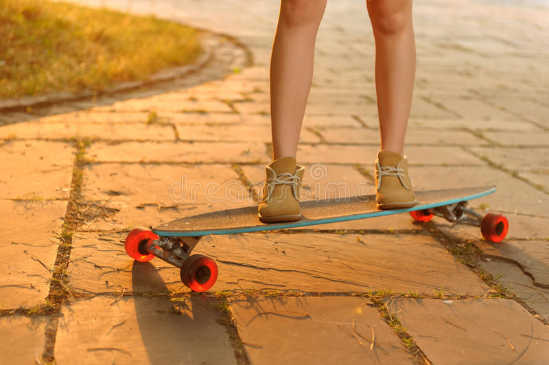 Nice girl riding skateboard royalty free stock photography