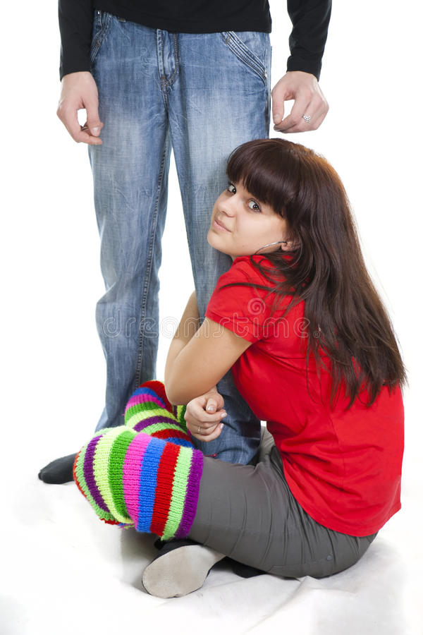 Nice girl sits having embraced boyfriend's leg. Nice girl sits having embraced a foot of the guy royalty free stock image