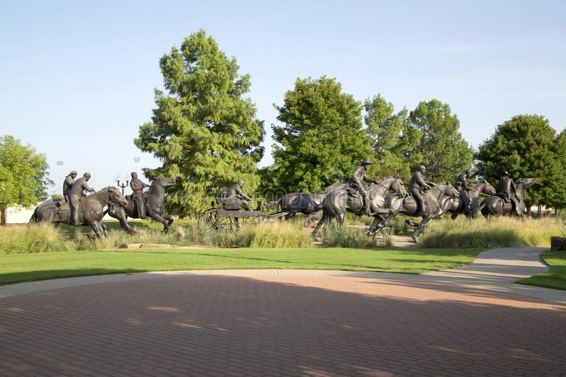 Nice group bronze sculpture in Centennial Land Run Monument. Group bronze sculpture in Centennial Land Run Monument sunset, city Oklahoma USA royalty free stock image