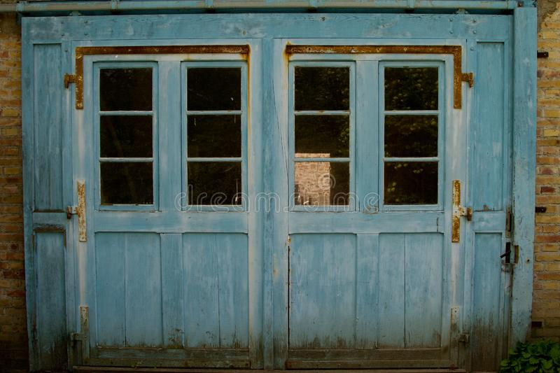 Blue door of Half timbered house in a village in Alsace royalty free stock image