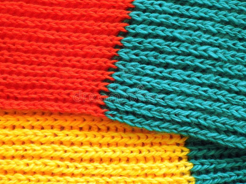 Beautiful soft knit scarf having Lithuanian flag colors royalty free stock image