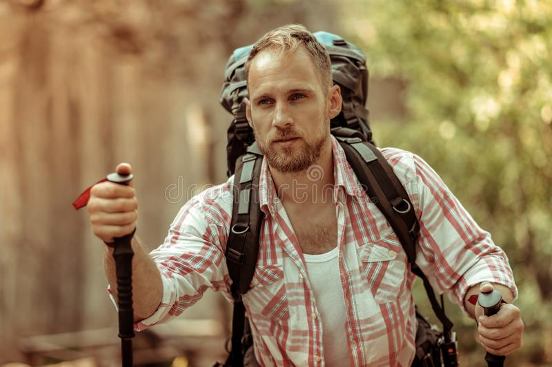 Nice handsome man holding a walking stick stock images