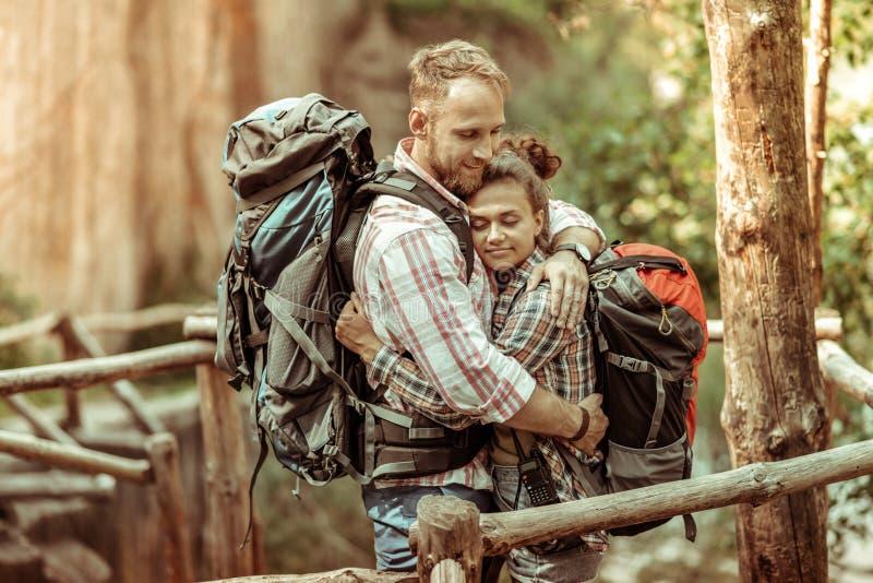 Nice handsome man hugging his beloved girlfriend stock image