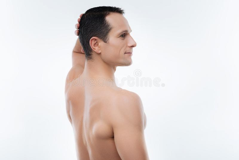 Nice handsome man standing half face royalty free stock image