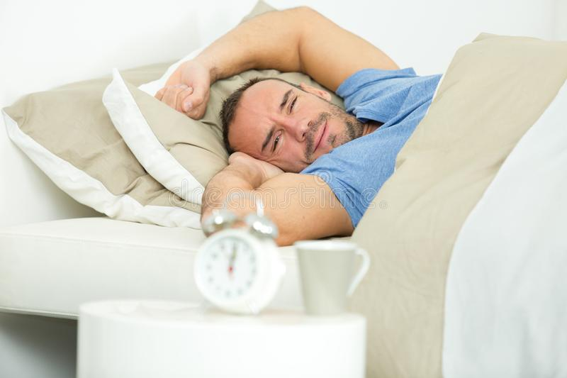 Handsome man waking up royalty free stock image