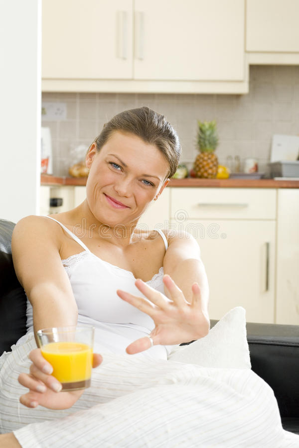 Nice happy woman relaxing at home royalty free stock photography