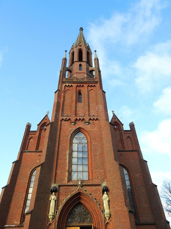 Beautiful red catholic church, Lithuania royalty free stock images