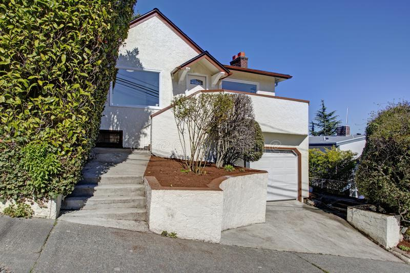 Nice home exterior with white stucco. And brown trim on a sunny day royalty free stock images