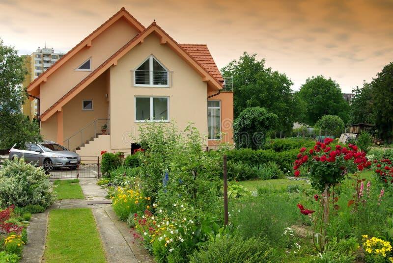 Nice house with the garden stock photos
