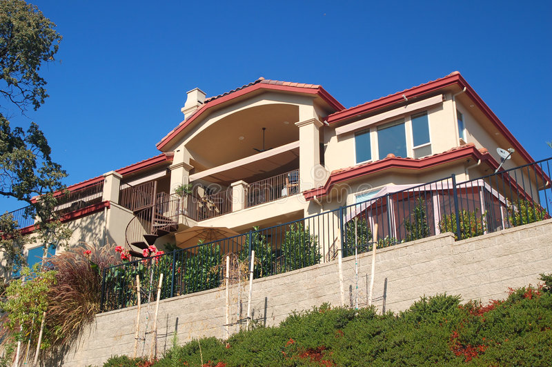 Nice house on hillside stock photography