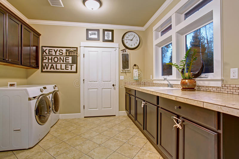 Download Nice Laundry Room With Tile Floor Stock Photo