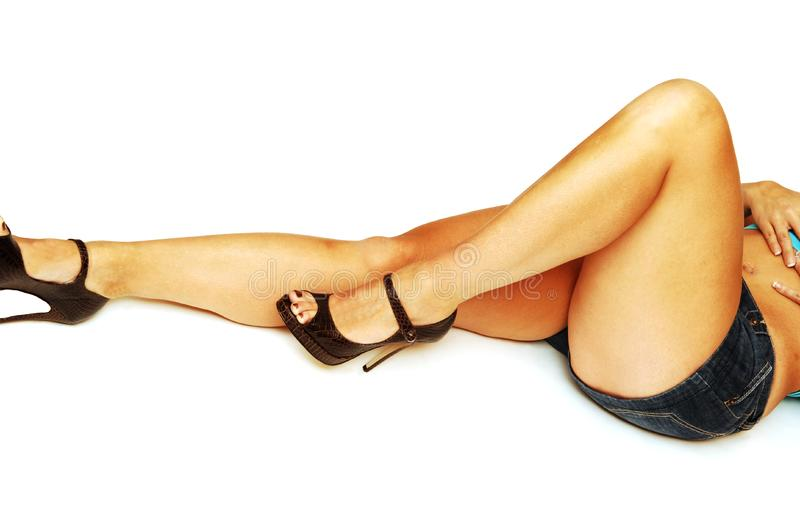 Nice legs laying on the floor. royalty free stock image