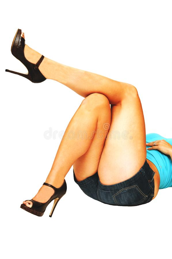 Nice legs laying on the floor. stock photos