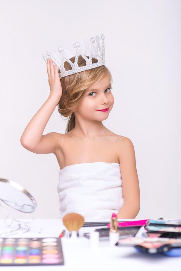 Nice little girl doing make up stock photos