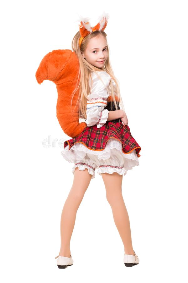 Nice little girl. Wearing like a squirrel showing her tail. Isolated on white royalty free stock images