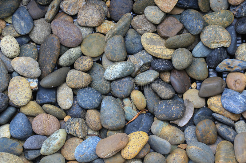 These nice little round colored pebbles were found alongside the beach where a river empties. This lovely natural pattern of pebbl royalty free stock photography