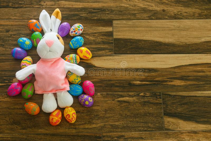 Nice little rabbit lies near easter eggs royalty free stock images