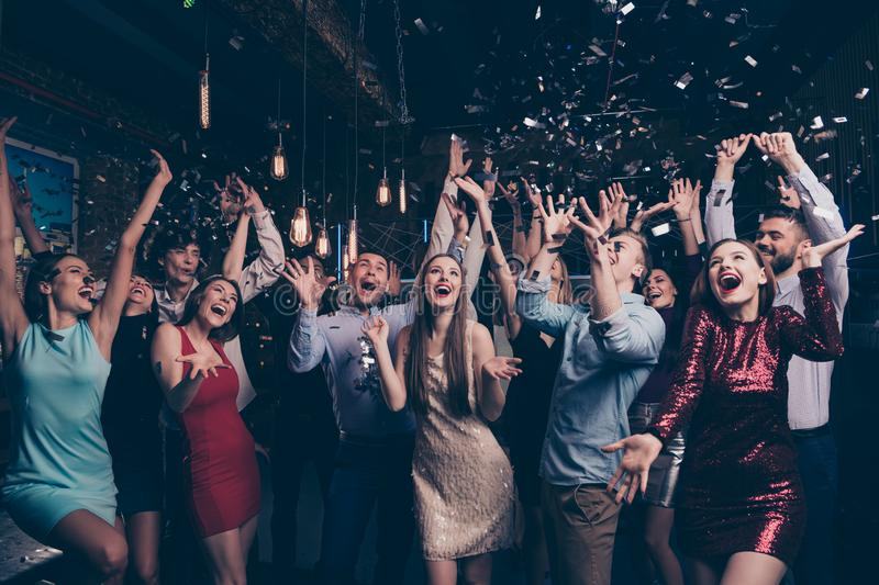 Nice-looking attractive gorgeous glamorous elegant stylish cheerful cheery positive girls and guys having fun bachelor stock images