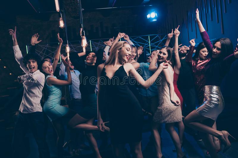 Nice-looking gorgeous attractive glamorous elegant cheerful glad positive stylish girl and guys having fun free time royalty free stock image
