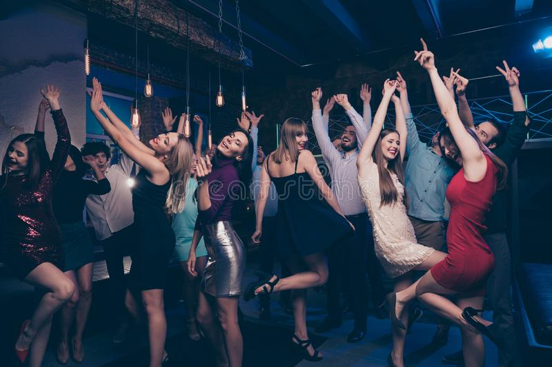 Nice-looking gorgeous attractive glamorous slim fit thin graceful cheerful positive stylish girls and guys having fun royalty free stock images