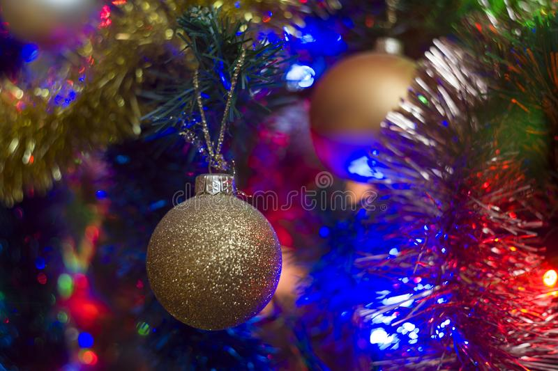 Christmas tree background with colorful Christmas lights and baubles royalty free stock photography