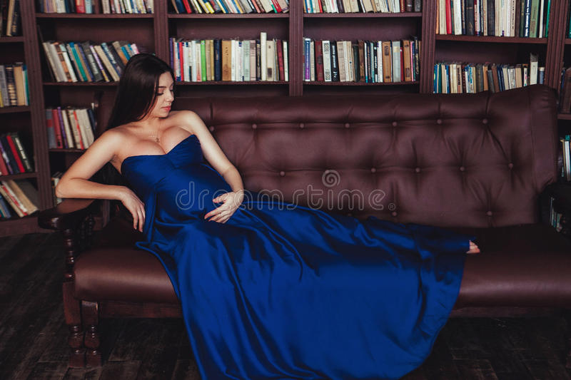 Nice looking pregnant woman in long dress. Concept of happy pregnancy royalty free stock images