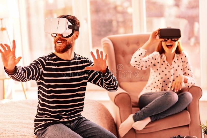Nice man and woman trying to play virtual reality stock images