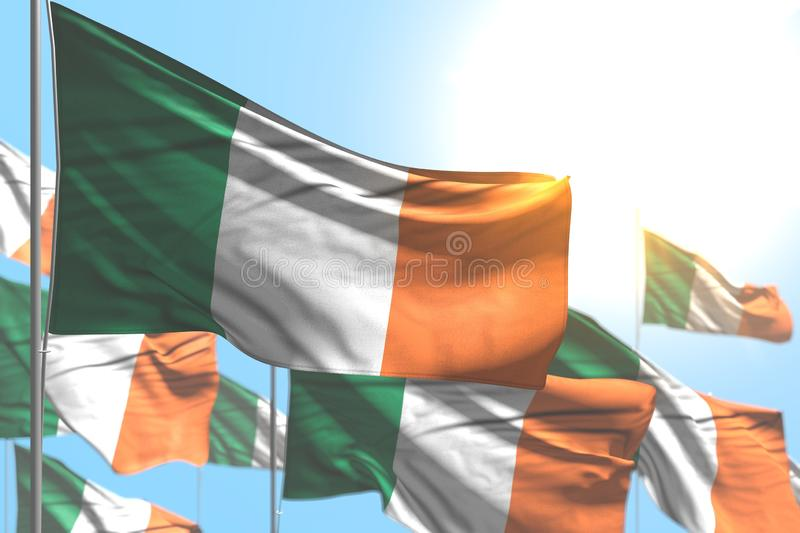 Nice many Ireland flags are waving against blue sky illustration with selective focus - any holiday flag 3d illustration. Nice any feast flag 3d illustration stock illustration