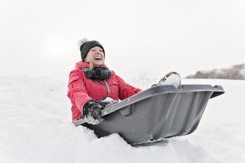 A nice Mother on sleigh ride. having fun lonely stock image
