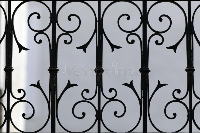 A nice motif of wrought iron, a detail of a railing royalty free stock image