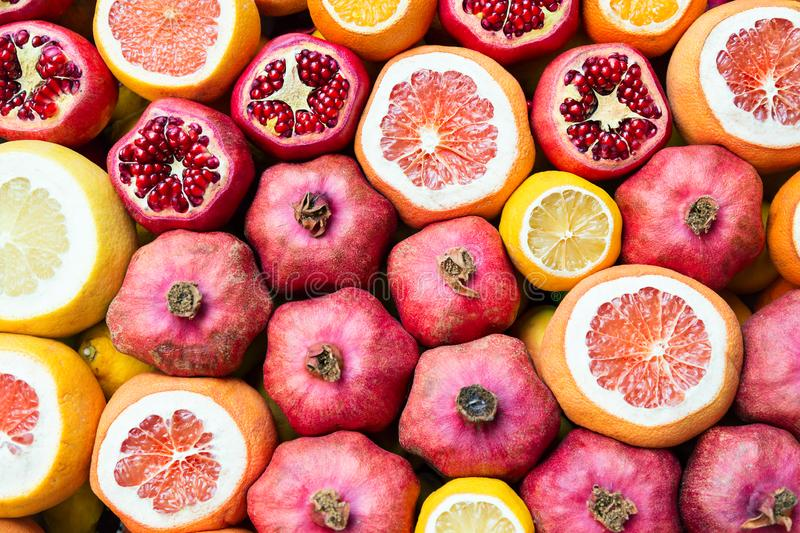 Nice natural background with pomegranates, oranges and grapefruits. Many opened fruits at a market in Istanbul, Turkey during. Sunny day royalty free stock images