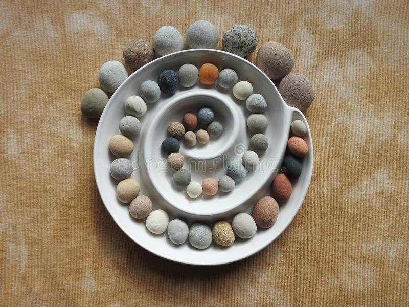 Beautiful round stones on brown fabric, Lithuania stock photo