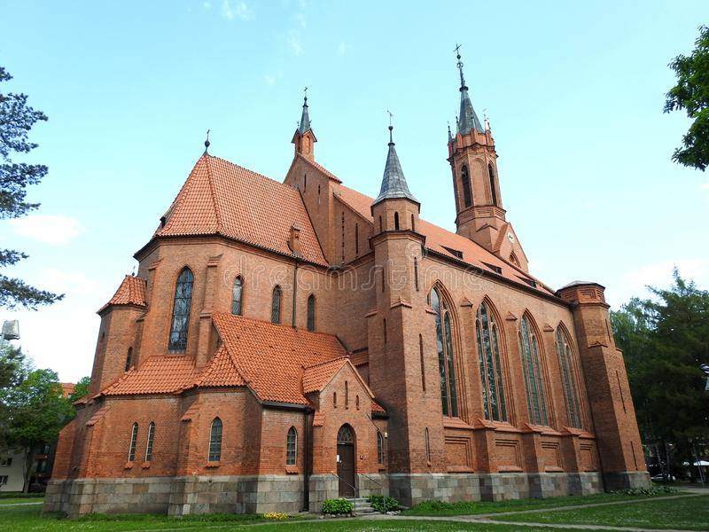 Old beautiful red catholic church, Lithuania royalty free stock images